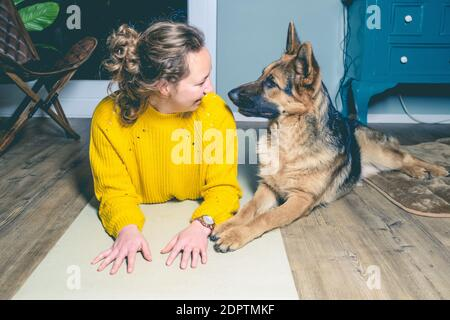 Vintage, retro photo of relaxing woman with her German shepherd. - Stock Photo