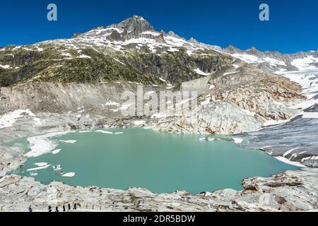 Alpine lake near Rhone Glacier, the source of Rhone river, Valais, Switzerland - Stock Photo