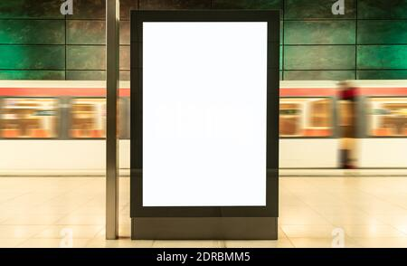 Blurred Motion Of Train At Subway Station With Blank Billboard In Foreground
