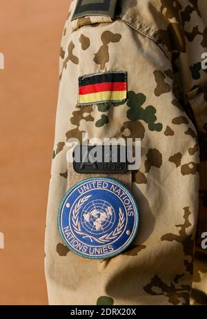 MALI, Gao, Minusma UN peace keeping mission, Camp Castor, german army Bundeswehr , camouflage uniform with german flag and UN sticker and blood group A + positive / MALI, Gao, UN Mission Minusma, Multidimensionale Integrierte Stabilisierungsmission der Vereinten Nationen in Mali, CAMP CASTOR der Bundeswehr, Uniform Jacke mit deutscher Flagge, UN Symbol und Blutgruppe A positiv - Stock Photo
