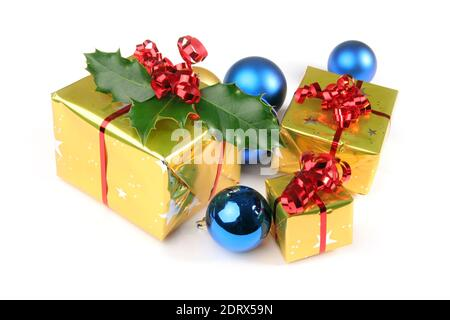 gifts with christmas decorations, christmas balls and holly isolated on white background