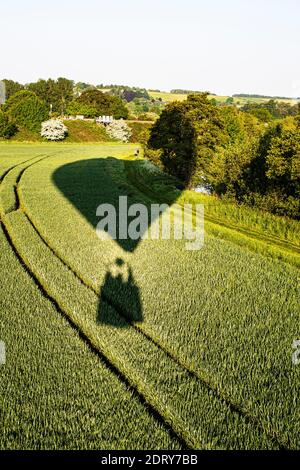 Balloon low flying over crop, Bristol, UK