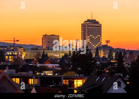 Illuminated Heart Shape On Building Windows In City Against Sky During Sunset
