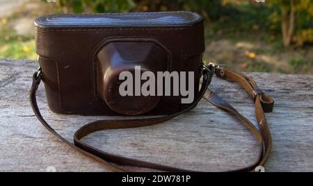 Leather case for old photo camera from last century - Stock Photo