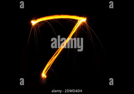 Number 7 Light Painting Against Black Background