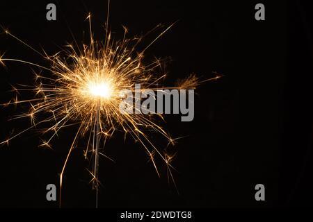 Close-up Of Sparkler Against Black Background