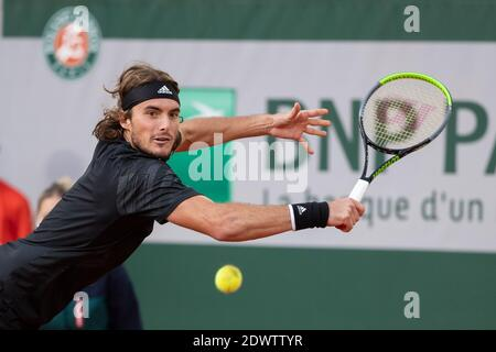 Greek tennis player Stefanos Tsitsipas playing a backhand during French Open 2020, Paris, France, Europe.
