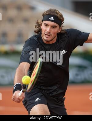 Greek tennis player Stefanos Tsitsipas playing a backhand volley during French Open 2020, Paris, France, Europe.