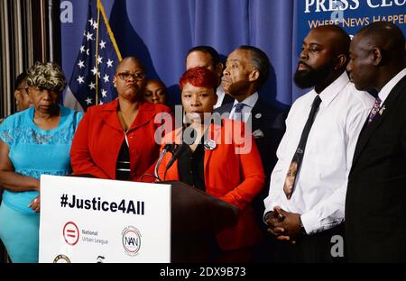 Michael Brown's parents, Michael Sr. and Lesley McSpadden speak as Gwen Carr (L), mother of Eric Garner looks on at a press conference to demand justice and accountability in the deaths of the unarmed men at the hands of police in Ferguson, Missouri and Staten Island, N.Y. during a press conference at the National Press Club in Washington, DC., USA on September 25, 2014. Photo by Olivier Douliery/ABACAPRESS.COM
