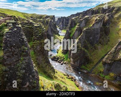 Scenic view of Fjadra river flowing through Fjadrargljufurcanyon
