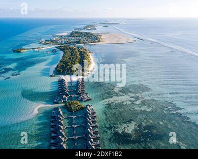 Maldives, Kaafu Atoll, Aerial view of bungalows of tourist resort on Huraa island