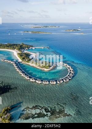 Maldives, Kaafu Atoll, Aerial view of bungalows of tourist resort on Kanuhuraa island