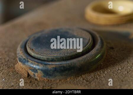 black old control button of an industrial control panel covered in dust - Stock Photo