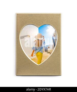 Cute summer photo in golden frame in shape of heart isolated on white background