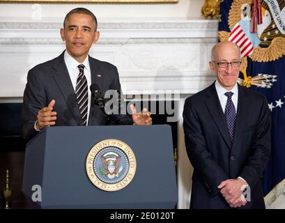 United States President Barack Obama, left, announces his intent to nominate Timothy Massad, right, as Chairman of the Commodity Futures Trading Commission (CFTC) during an event in the State Dining Room of the White House in Washington, DC, USA, on Tuesday, November 12, 2013. Photo by Ron Sachs/Pool/ABACAPRESS.COM - Stock Photo