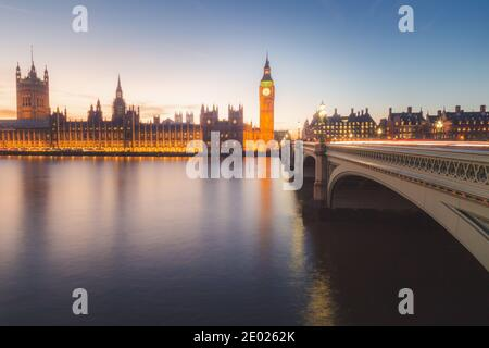 A long exposure capture at night of Elizabeth Tower formerly Big Ben of Westminster Abbey from the Thames riverside. - Stock Photo
