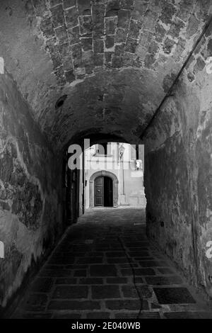 A covered alley in the historic medieval village of Scansano, Grosseto Province, Tuscany, Italy