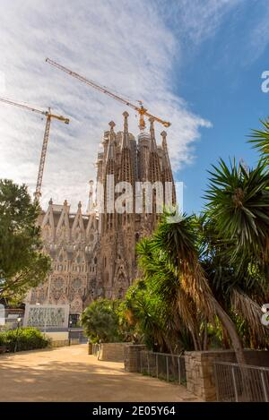 Barcelona, Spain: December 30 2020: Basicila and Expiatory Church of the Holy Family, known as Sagrada Familia at sunset in COVID Time.