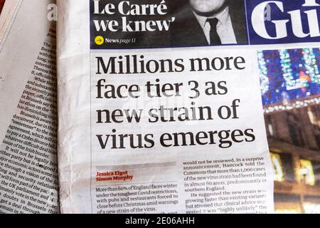 Guardian front page newspaper headline 'Millions more face tier 3 as new strain of virus emerges' London England UK 14 December 2020 Stock Photo