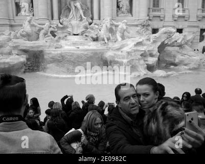 AJAXNETPHOTO. 2015. ROME, ITALY. - ROMAN ATTRACTION - VISITORS AT THE TREVI FOUNTAIN MAKING A 'SELFIE'. PHOTO:JONATHAN EASTLAND/AJAX REF:GXR151012_5839 Stock Photo