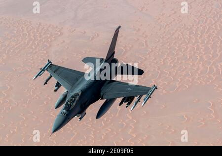 Persian Gulf, United States. 30th Dec, 2020. A U.S. Air Force A U.S. Air Force F-16 Fighting Falcon fighter jet approaches a KC-135 Stratotanker for refueling December 30, 2020 over the Persian Gulf. The fighter is an escort for B-52 Stratofortress strategic bombers during a show of force mission as a message to Iran. Credit: Planetpix/Alamy Live News - Stock Photo