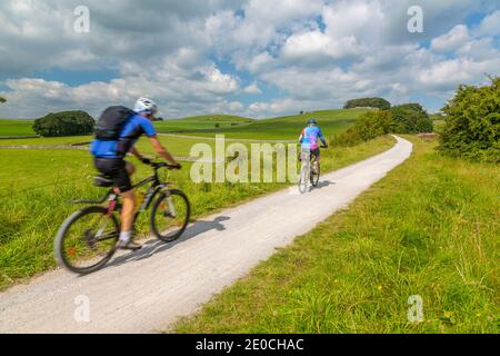 View of cyclist on the Tissington Trail, Tissington, Peak District National Park, Derbyshire, England, United Kingdom, Europe Stock Photo