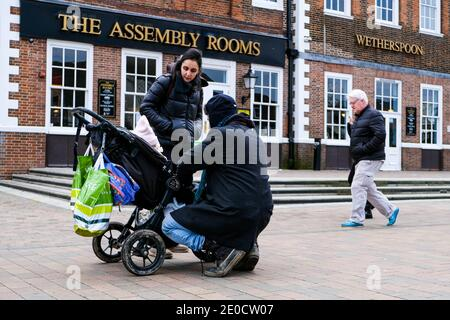 London UK, December 31 2020, Young Couple With A Baby In A Pushchair And Waitrose Shopping Bags