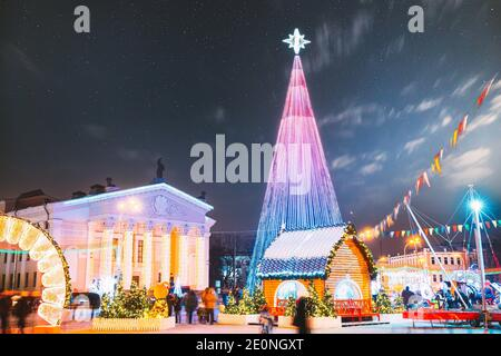 Gomel, Belarus. Main Christmas Tree And Festive Illumination Decorations On Lenin Square In Gomel. New Year In Belarus. Altered Starry Sky With Night