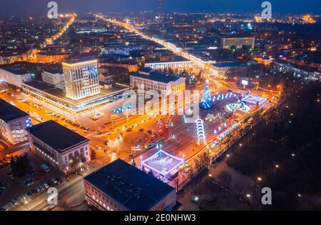 Gomel, Belarus. Main Christmas Tree And Festive Illumination On Lenin Square In Homel. New Year Celebration In Belarus. Aerial Night View.