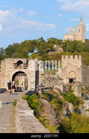 Main gate of Tsarevets fortress on the hill with same name in Veliko Tarnovo, Bulgaria. Patriarchal Cathedral of the Holy Ascension of the Lord on top - Stock Photo