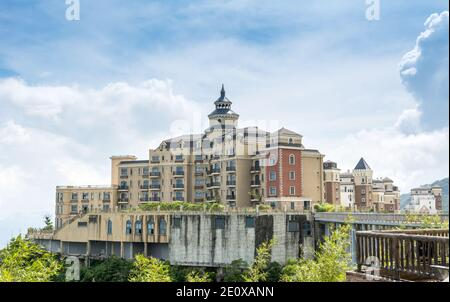 A modern castle against cloudy sky in Overseas Chinese Town (OCT) East of Shenzhen, China - Stock Photo