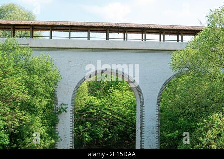 Moscow, Russia - June 9, 2020: Waterworks aqueduct in the Yauza River Valley in Moscow. Historical aqueduct of the 18th century made of white stone in