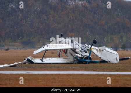Biplane aircraft crashed by very strong wind 'bura' ying inverted turned-over An-2 9A-BAD owned by Grobnik airport para-club on Nov. 23, 2005 - Stock Photo