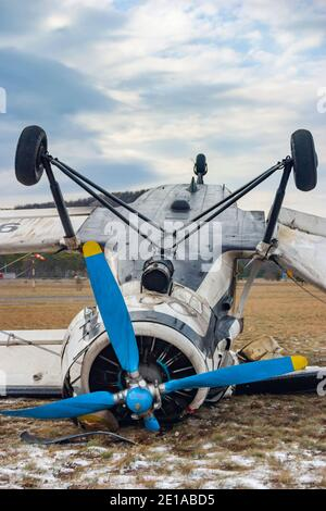 Biplane aircraft mishap crashed by very strong wind 'bura' lying inverted turned-over An-2 9A-BAD owned by Grobnik airport para-club on Nov. 23, 2005 - Stock Photo