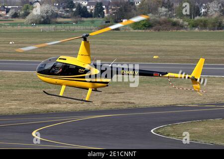 Air Lloyd Robinson R44 Raven I helicopter with registration D-HALV at Bonn Hangelar Airport.