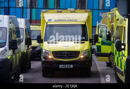 London, UK. 7th Jan, 2020. Lines of Ambulances outside the Royal London hospital as the NHS is under severe pressure as the cases of Covid-19 increase. The UK has gone into a National Lockdown following the big surge in Covid cases. There have been over 2.8 Million confirmed cases in the UK with over 77,000 deaths. Credit: Mark Thomas/Alamy Live News Stock Photo