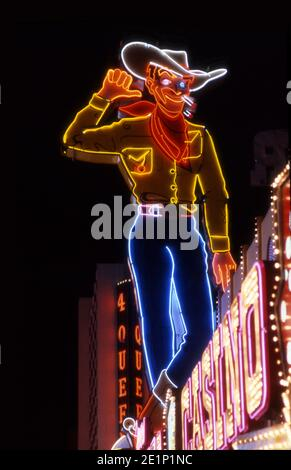 Iconic neon cowboy sign on Fremont Street in Downtown Las Vegas, Nevada