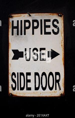 'Hippies Use Side Door';  Ironic (presumably) and amusing sign on property in Ladbroke Grove, London