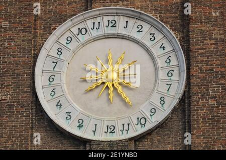 Clock on the bell tower of the Church of the Holy Apostles of Christ in Venice, Italy