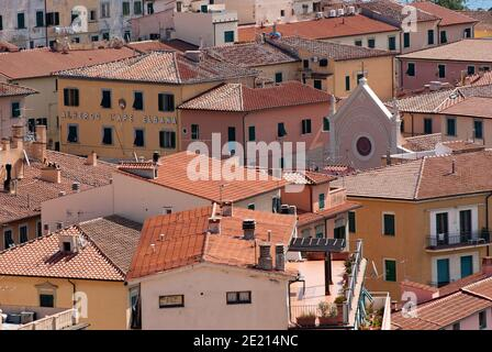 Portoferraio village with the top of the Nativity of the Blessed Virgin Mary Church standing out among the houses, Elba Island, Tuscany, Italy