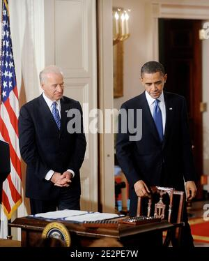 US President Barack Obama and Vice President Joe Biden stand next to the health insurance reform bill in the East Room in Washington, DC, USA, on March 23, 2010. Photo by Olivier Douliery/ABACAPRESS.COM