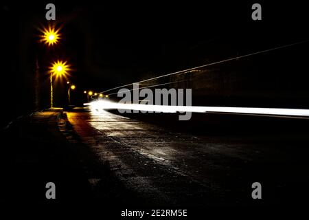 A dark olt tunnel with light trails.