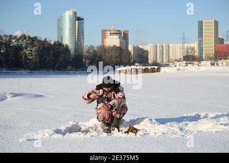 MOSCOW, RUSSIA - JANUARY 17, 2021: A man fishes in the frozen Butakovsky Bay of the Khimki Reservoir. Maxim Churusov/TASS