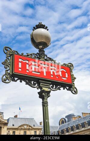 A métro sign at the Louvre station, Paris, France