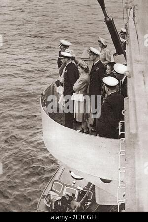 EDITORIAL ONLY Princess Elizabeth of York and Prince Philip, seen here when he was Lieutenant Philip Mountbatten, accompanying her father King George VI on board the H.M.S. Maidstone during an inspection of the Home Fleet in the Clyde.  George VI (Albert Frederick Arthur George),1895 –1952. King of the United Kingdom and the Dominions of the British Commonwealth.  Princess Elizabeth of York, future Elizabeth II, born 1926.  Queen of the United Kingdom.  Prince Philip, born Prince Philip of Greece and Denmark, 1921. Husband of Queen Elizabeth II of the United Kingdom.  From The Queen Elizabeth
