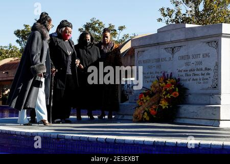 Family members lay a wreath at the tomb of Martin Luther King Jr. and Coretta Scott King during Martin Luther King, Jr. Day in Atlanta, Georgia, U.S. January 18, 2021. REUTERS/Chris Aluka Berry - Stock Photo