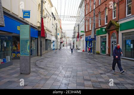 A near deserted main shopping area of Strand Street in Douglas, Isle of Man during a three week lockdown for Covid during January 2021