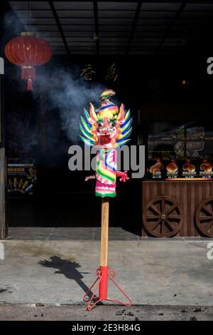 A traditional dragon joss stick burning. These offerings can be found in front of homes, shops and temples during traditional Chinese festivals. - Stock Photo