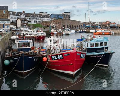 Fishing boats moored in Seahouses harbour in Northumberland England UK - Stock Photo