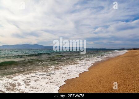Sandy beach ofAgios Prokopios during a windy day, in Naxos island, Cyclades, Greece, Europe. - Stock Photo